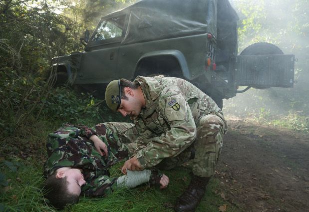 First aid after a vehicle crash by members of 3PWRR