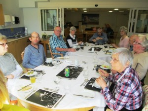 Residents at Weston Hospice enjoying a meal using cutlery donated by the Cutlers' Company.